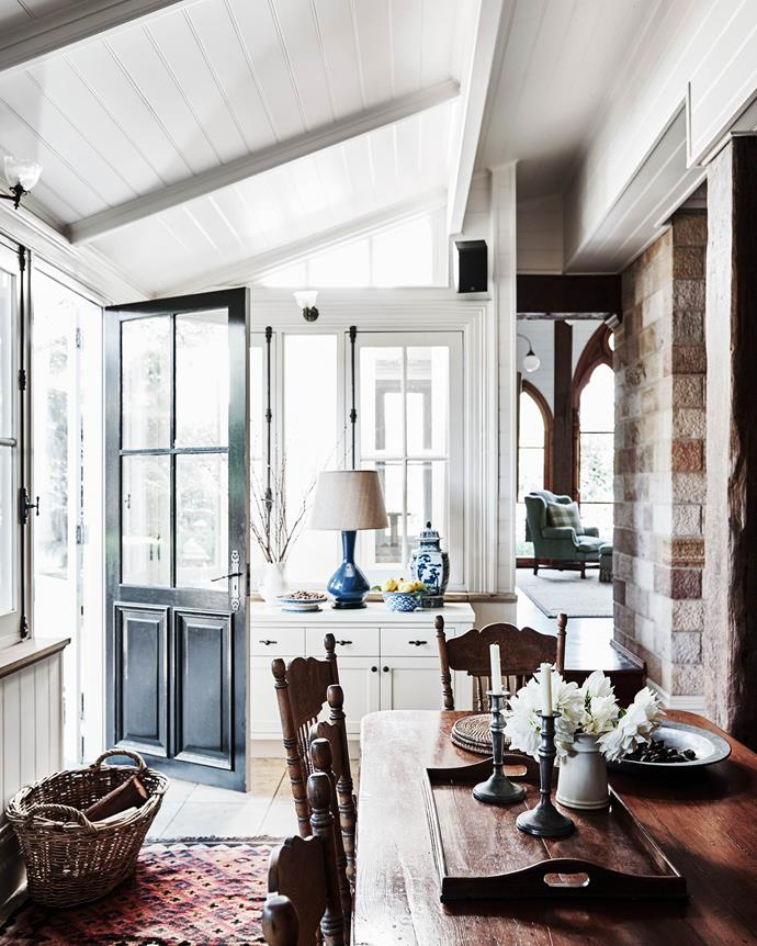 The kitchen and dining area adjoins the side entrance. | *Photography: Lisa Cohen | Styling: Tess Newman-Morris*