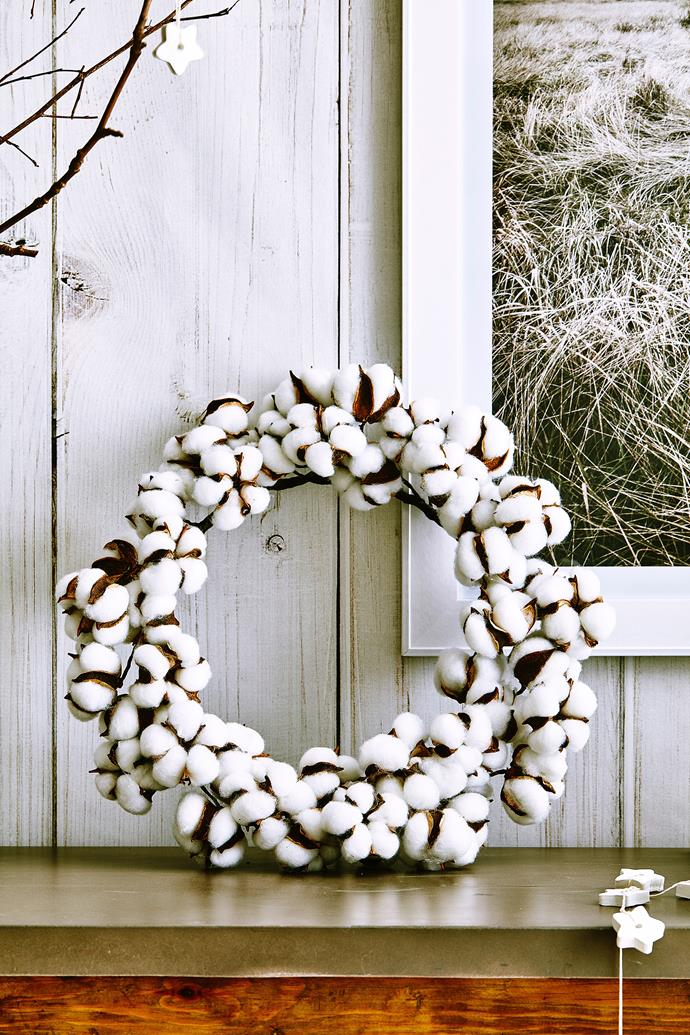 Your wreath doesn't have to live on the front door. Lean one against a wall for renter-friendly decorating.