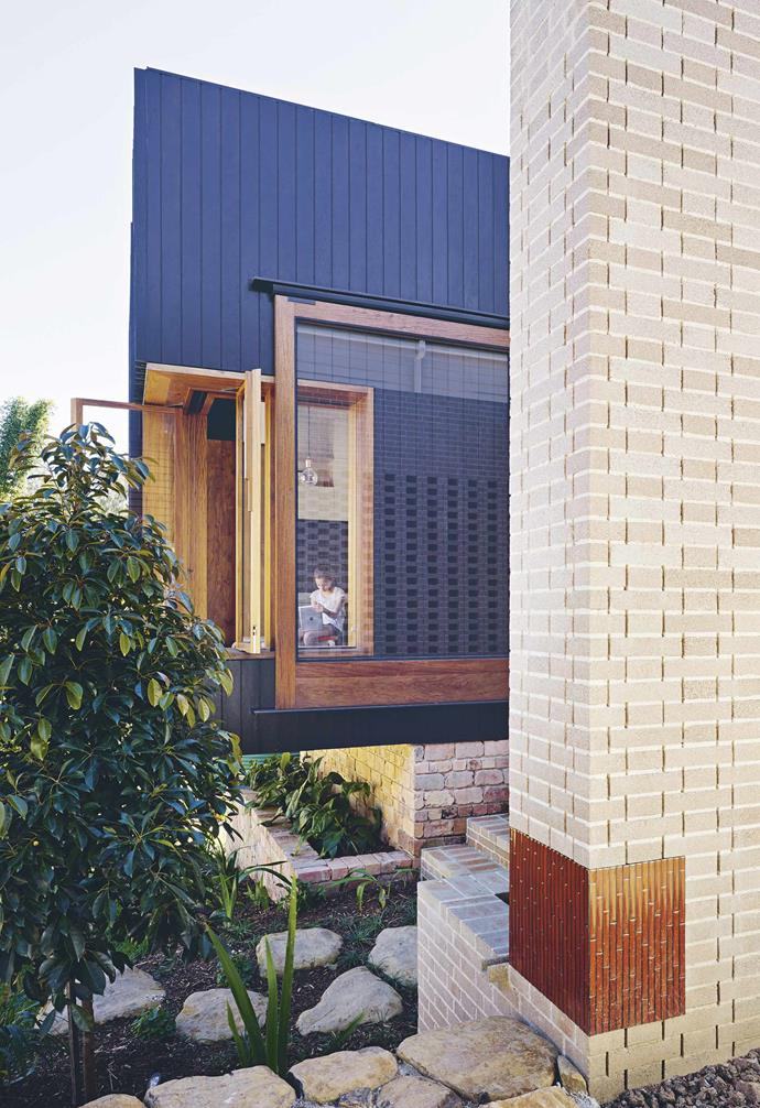 **Living space** The new living area is cantilevered over the garden. An original brick chimney at the front of the house is referenced in new brickwork at the rear.