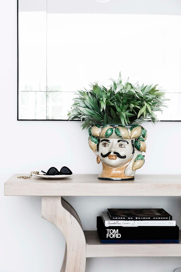 The head vase is by ceramicist Giacomo Alessi.