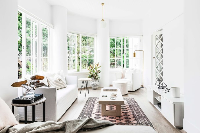 The bank of windows in the front living room were a major drawcard for Jon and Kate. Custom-fit, sheer roller blinds blend in seamlessly, so as not to detract from their heritage features.