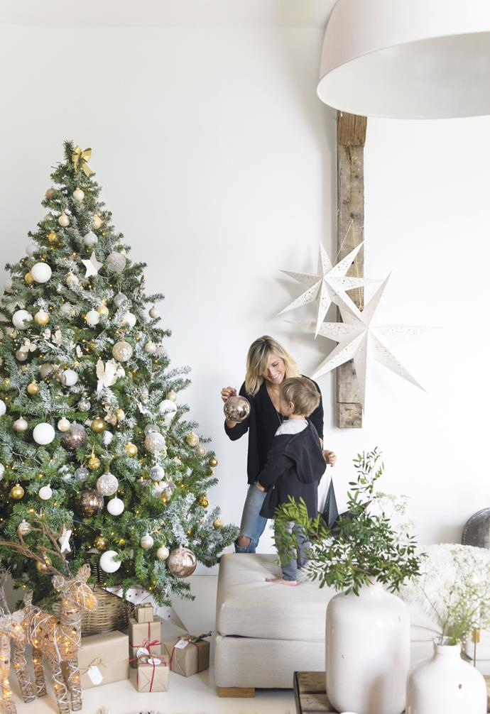 "**Christmas tree** The faux Christmas tree, lightly frosted and decorated with baubles in white, cream and gold, is the centrepiece of this festive setting. Paper stars from [IKEA](https://www.ikea.com/|target=""_blank""
