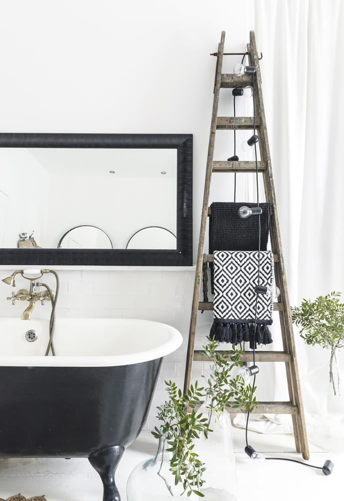 **Bright idea** A rustic ladder is repurposed as a towel rack.