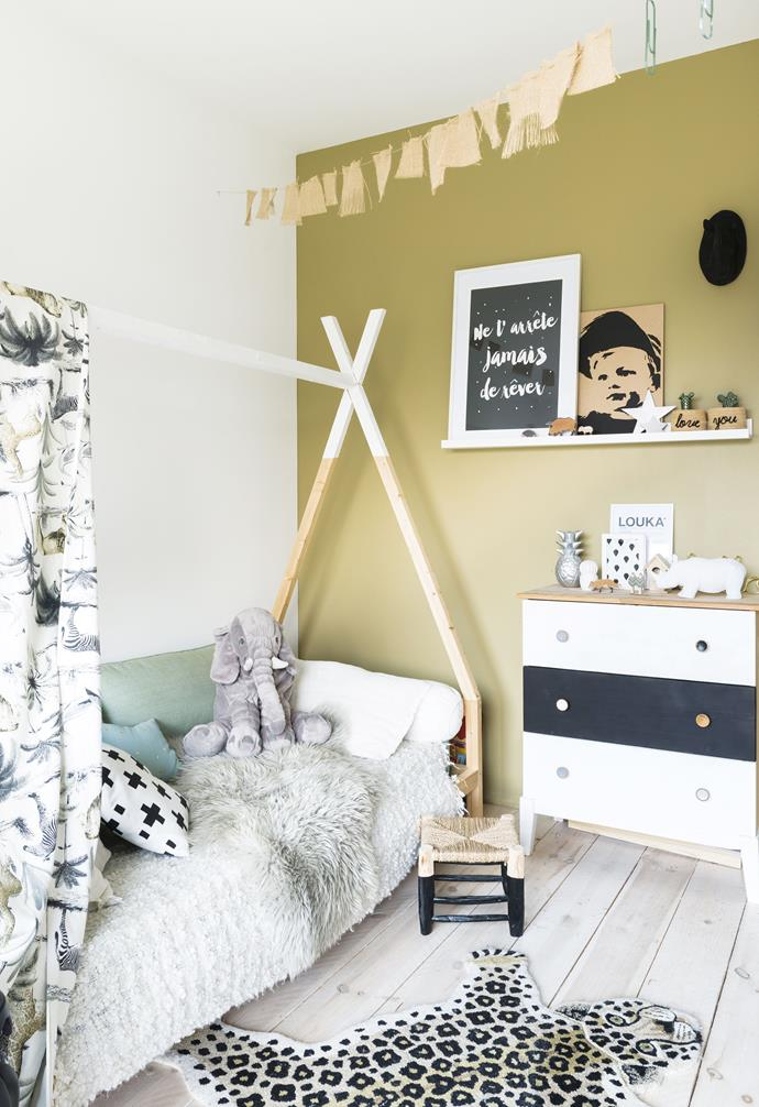 "**Louka's bedroom** The stylist made her son's teepee bed herself from wooden brackets over which she draped a wildlife-print fabric. A leopard-print rug adds to the room's exotic theme. The fur throw is from [Zara Home](https://www.zarahome.com/au/|target=""_blank""