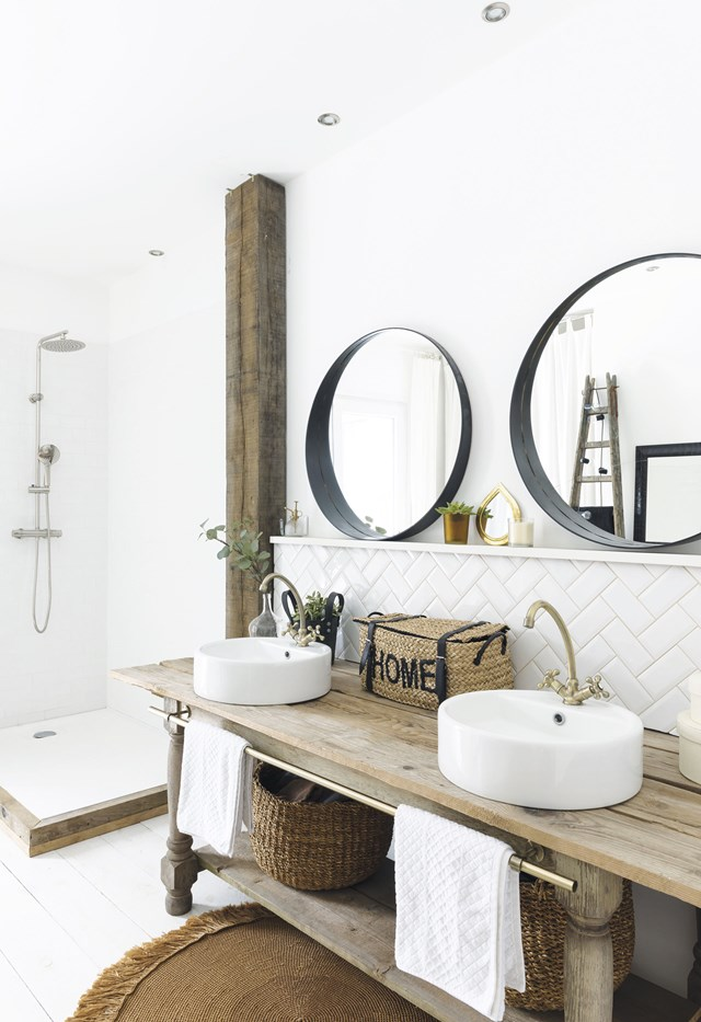 "Without a doubt, the hero feature of this bathroom is the vanity, made from a converted old workbench in this [converted red-brick barn home](https://www.homestolove.com.au/converted-red-brick-barn-home-19387|target=""_blank""). To keep the look fun and fresh, subway tiles have been laid in a herringbone pattern. *Photo: Julien Fernandez / Story: Inside Out*"