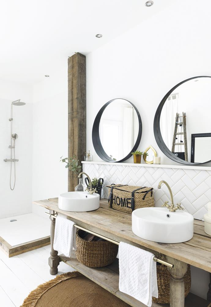 "**Bathroom** In the bathroom, an old workbench has been converted into a vanity that accommodates twin vessel basins and swan neck taps. Subway tiles in a herringbone pattern form a stylish splashback as well as a ledge for the pair of circular [IKEA](https://www.ikea.com/|target=""_blank""