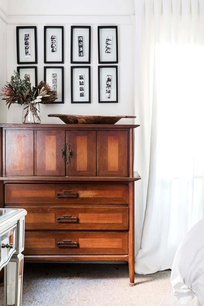 Vintage armoire beneath framed photobooth images.