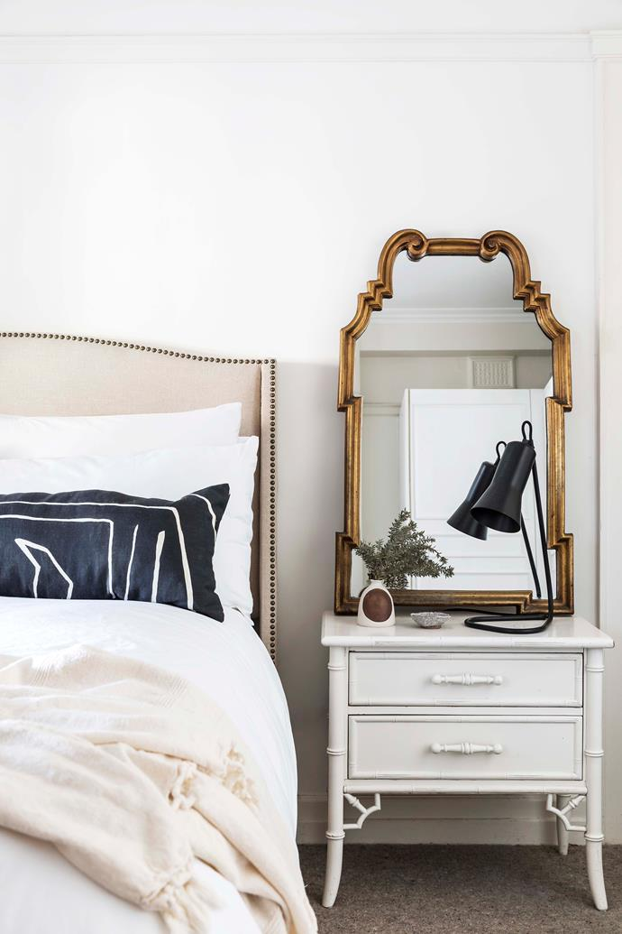 In the bedroom, the cushion in Kelly Wearstler 'Graffito' fabric from Elliott Clarke. Vintage mirror and bedside with 'Silhouette' table lamp by Ross Gardam from Stylecraft.