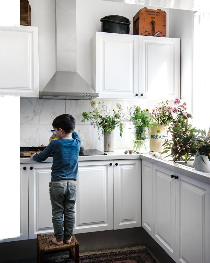 The 1980s kitchen was still in good condition so Lauren simply painted the cabinets white.   *Photography: Brigid Arnott   Styling: Kristen Wilson*