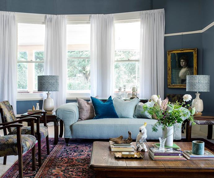 In the sitting room, linen curtains let in more light than the old velvet drapes.  *Photography: Brigid Arnott   Styling: Kristen Wilson*
