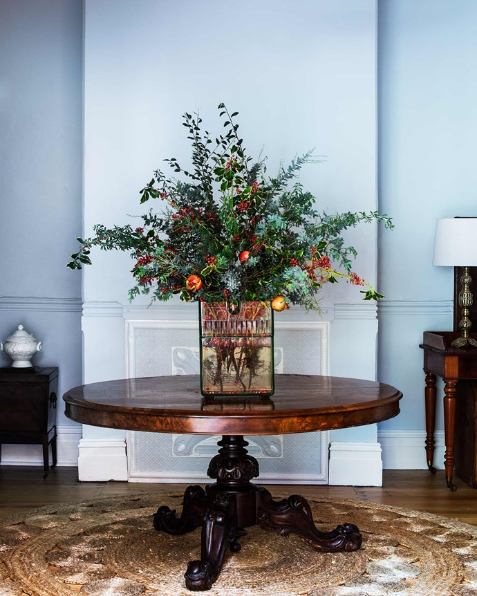 The pedestal table in the grand entryway was the home's original dining table. | *Photography: Brigid Arnott | Styling: Kristen Wilson*