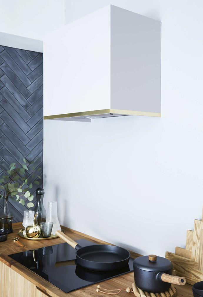 **Details** The brass trim on the white rangehood echoes the brass tapware and highlights in the rest of the space.