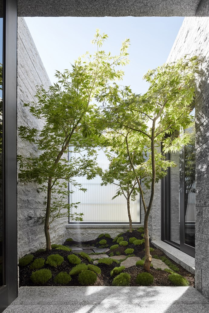 The bathroom opens out onto its own Japanese-style courtyard.