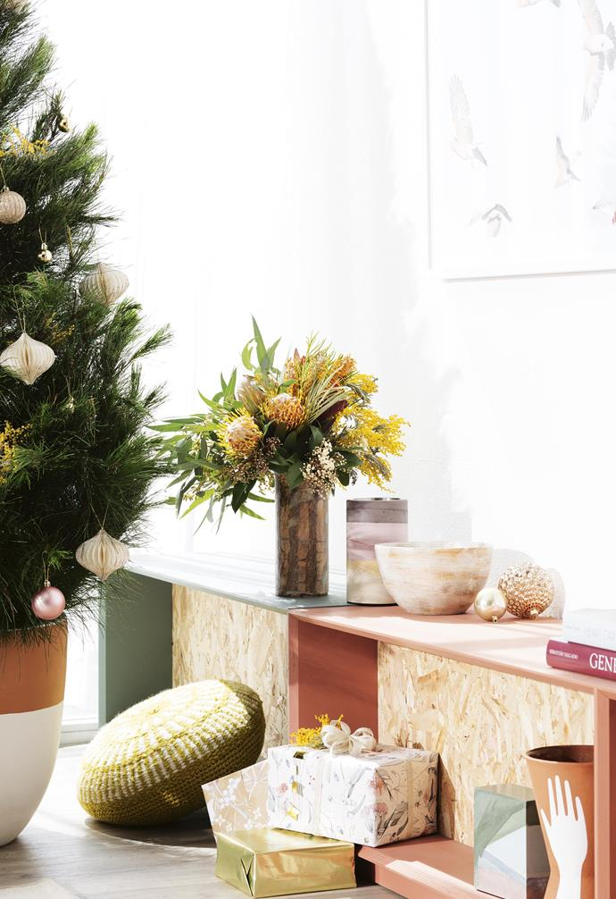 "**Keep it simple** We love the clever tree-in-a-pot idea in this Christmas set-up. See more of this stunning look and find out [which Christmas style are you here](https://www.homestolove.com.au/which-christmas-style-are-you-18168|target=""_blank""). *Styling by Jono Fleming 
