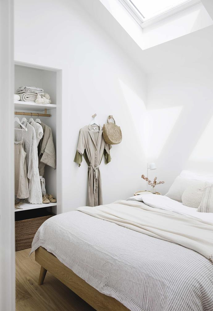 "**Bedroom** Lauren's thoughtful details are evident throughout, including the simple wardrobe rails in Tasmanian oak. Michael created hooks from wardrobe rail offcuts. The West Elm basket is perfect for shoe storage. Oslo bed, [Freedom](https://www.freedom.com.au/|target=""_blank""