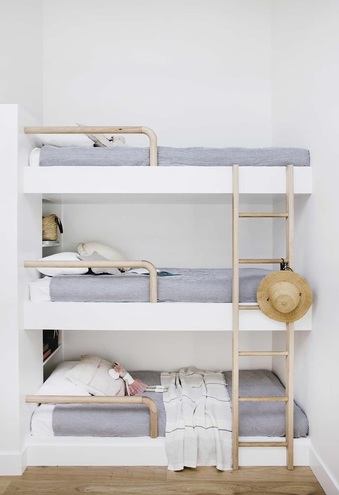 "**Kids' bedroom** The triple bunk bed was inspired by an image on Pinterest. Michael custom-built the timber railings and ladder using Tasmanian oak. Round cushion, [Pampa](https://pampa.com.au/|target=""_blank""