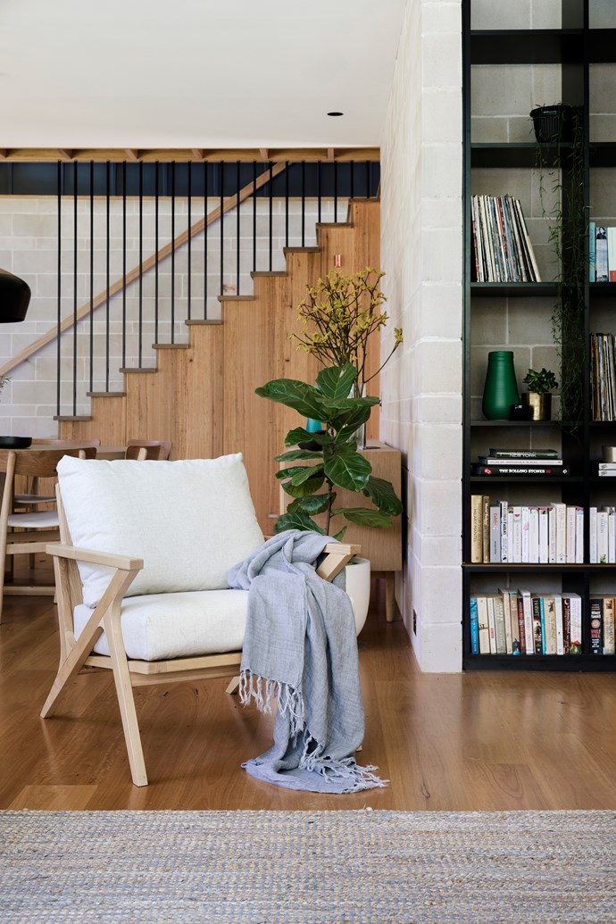 "Backless black shelving emphasises the character of the cement-block wall. The staircase is fitted with galvanised-iron rods treated with anti-corrosion paint. A 'Vittoria' chair from GlobeWest has been paired with an [L&M Home](https://www.lmhome.com.au/collections/living/products/isola-throw?variant=8857726058550|target=""_blank""