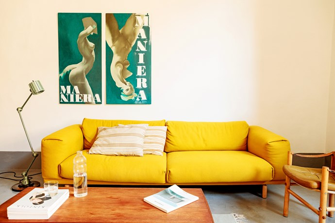 "In share house living rooms, mixing furniture from several design decades can feel stuffy, so Andrew looked for pieces from the '50s and '60s. ""He helped me find furniture in Italy, Spain, Portugal and England,"" Martino says. The yellow Rest sofa is from Muuto, beside it is a Lampe Gras lamp and the artwork is by Kreshnik Aliaj."