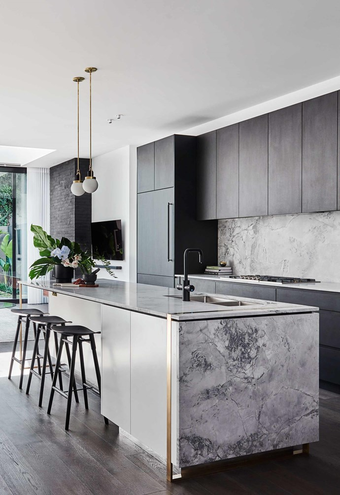 "**Colour contrast** Dark cabinetry in the kitchen makes the light marbled stone on the [island bench](https://www.homestolove.com.au/kitchen-inspiration-13-of-the-best-island-benches-17943|target=""_blank"") and [splashback sing](https://www.homestolove.com.au/12-splashback-ideas-that-arent-white-subway-tiles-17258