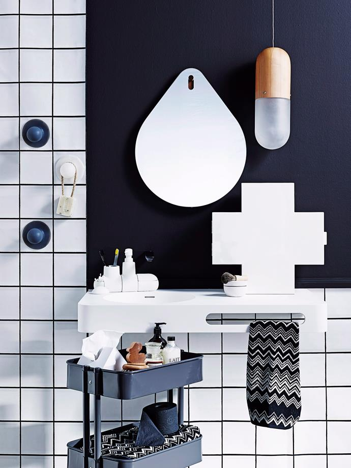 A handy storage trolley can work wonders in a small bathroom. *Photo: Brett Stevens / bauersyndication.com.au*