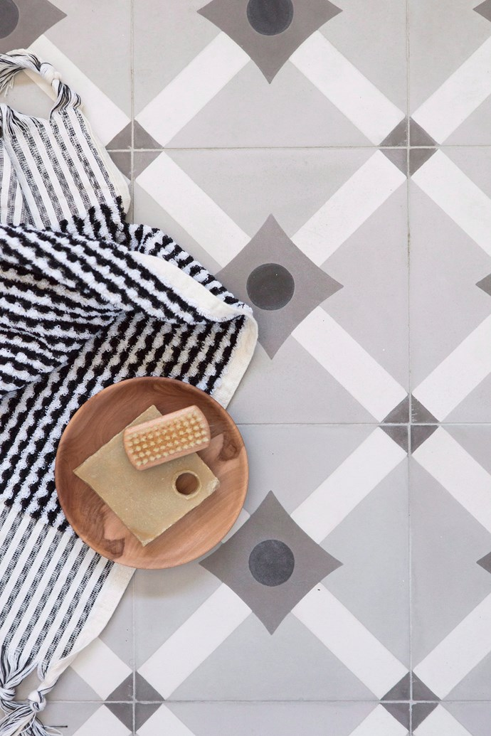 A set of fluffy towels in fun geometric patterns will instantly lift the entire look of your bathroom while timber accessories add warmth. *Photo: Bo Wong / bauersyndication.com.au*