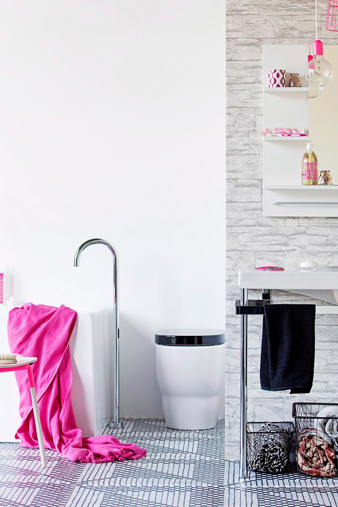 A toilet rug draws unnecessary attention to the least attractive area of your bathroom (and will only harbour germs). Keep the space clean and clear and use bright towels to draw attention to things like your bathtub and vanity. *Photo: Maree Homer / bauersyndication.com.au*