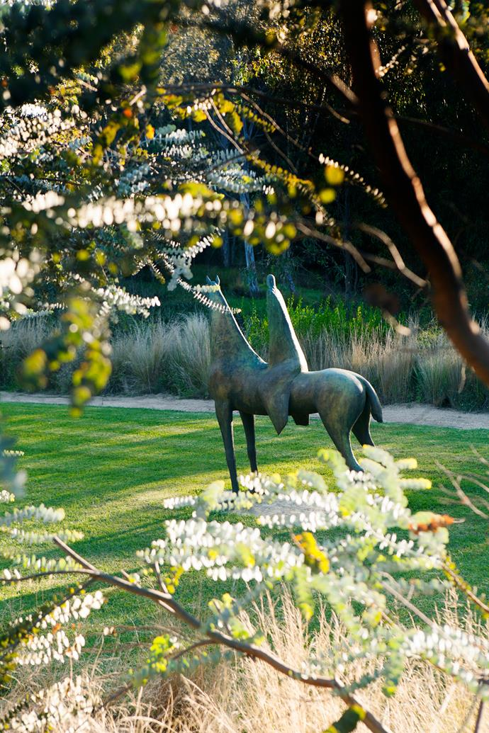 An eye-catching bronze work by Australian sculptor Shona Nunan, takes pride of place in the lawn section of this Melbourne garden, located on a stretch of Yarra River floodplain.