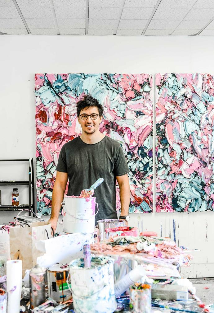 Artist Alesandro Ljubicic in his studio with his *Magnolia Linen Mist (2017)* draws inspiration for his artworks from the beauty of botanicals. *Photography Mitch Lui*.