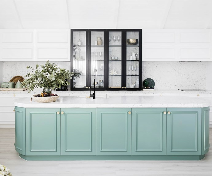 """**#kitchengoals** """"I'd been thinking of a dirty pink for the island, but once I got into the house I went with green,"""" says Bonnie. A sleek fridge and induction cooktop from Electrolux with matching mint green appliances from [DeLonghi](https://www.delonghi.com/en-au