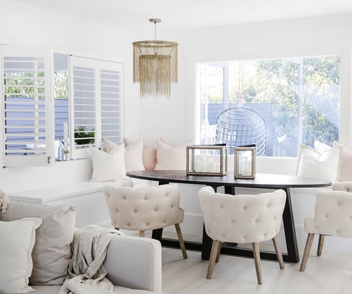 """**#wineanddine** A corner bench seat (with good storage underneath, thanks to Erin) frames the oval table in the main dining area. The large window lets the outside in, while [Luxaflex](https://www.luxaflex.com.au/