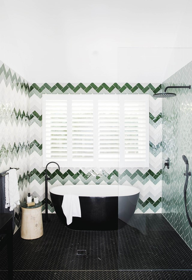 "This striking bathroom features green, grey and white tiles from Tile Cloud in a zigzag pattern devised by Bonnie Hindmarsh of [Three Birds Renovations](https://www.threebirdsrenovations.com/|target=""_blank""