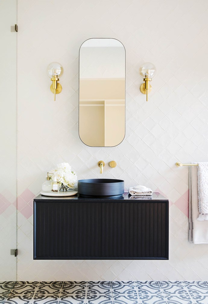 """**#blushcrush** The shade of pretty, but slightly gritty, pink that's one of Bonnie's go-to colours makes an appearance in the main bedroom. But was it too feminine for the male half of the couple who own the house? """"Look, we balanced out the pink with black accents like the mirror, wall lights and curtains, and the room looks out onto a courtyard surrounded by black cladding. He was fine with it!"""" says Bonnie. In the ensuite, a vanity and mirror from [Reece](https://www.reece.com.au/