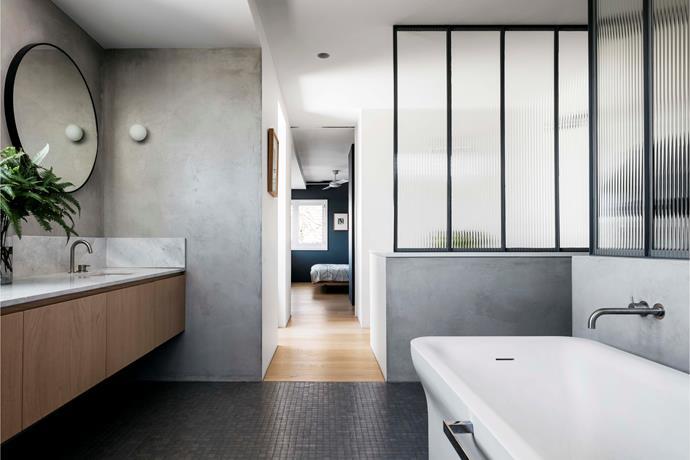 A Custom Pilkington Texture Glass Reeded screen in the ensuite bathroom maximises natural sunlight. Flos 'Mini Glo-Ball' light from Euroluce. Agape 'Novecento' bath from Artedomus.