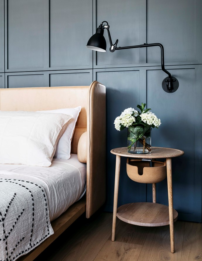 "The master bedroom features an 'Aran' bed in Contemporary Leathers 'Verona' leather from Cult. Studioilse 'Companions' bedside table and Gras '303' wall lamp both from [Spence & Lyda](https://www.spenceandlyda.com.au/|target=""_blank""