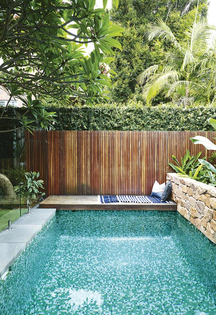 """""""It's a beautiful home, and the original backyard just didn't do it justice,"""" says Josh. """"Lucy and Dave provided us with their priorities and then let us have free rein over the design. There was a lot to fit into such a small space, and we didn't want to overcomplicate the design or make the garden feel cluttered.""""<br><br>**Pool deck** Narrow spotted-gum fencing creates a warm, natural boundary. [The deck](https://www.homestolove.com.au/5-common-mistakes-people-make-when-building-a-deck-16006