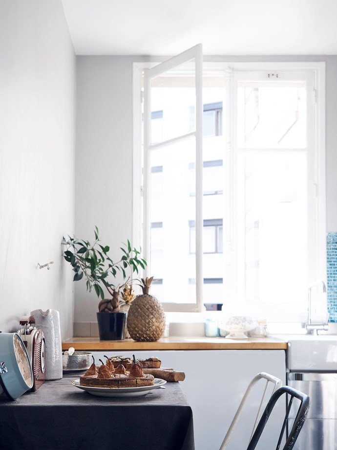 Héloïse takes in the city views and generous light while working in her kitchen.
