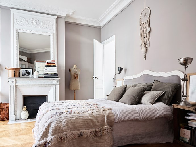 In the master bedroom, a Moroccan wedding blanket is draped across the bed, a mannequin that once belonged to Héloïse's grandmother stands next to the fireplace and a dreamcatcher purchased in Greece decorates the wall.