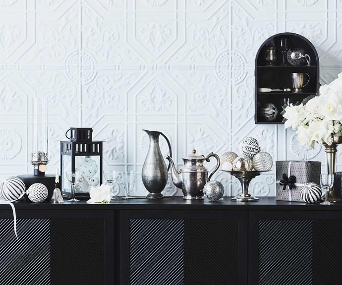 "**In black and white** Mix vintage silver or pewter pieces with monochromatic decorations and flowers for a sophisticated take on the season. This scene is a vintage monochrome look that allows for traditional pieces to be placed seamlessly throughout. For Jono, the mercury glass and pewter accents are key. *Styling: Jono Fleming with assistance by Nonci Nyoni and Olivia Hutchinson | Photography: Maree Homer*.<br><br>**Get the look** 'Harper' buffet, $3915, [Globe West](https://www.globewest.com.au/|target=""_blank""