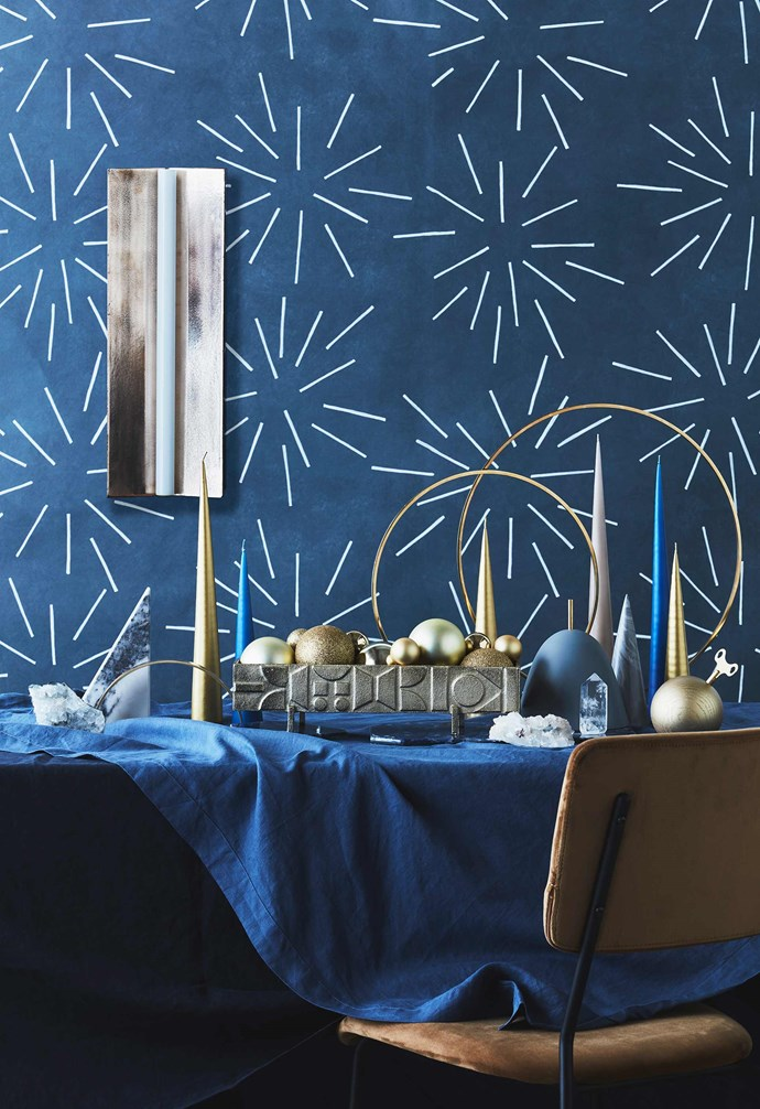 "**Set to sparkle** Create a festive tablescape with ornaments and candles in a mix of shapes and heights. For the elegant modern scape, Jono paired deep navy tones with bright golds and minimalist tree shapes with some sparkle to add some sophistication to your table. *Styling: Jono Fleming with assistance by Nonci Nyoni and Olivia Hutchinson | Photography: Maree Homer*.<br><br>**Get the look** 'Longton' wall light, $2695, [Volker Haug Studio](https://www.volkerhaug.com/|target=""_blank""