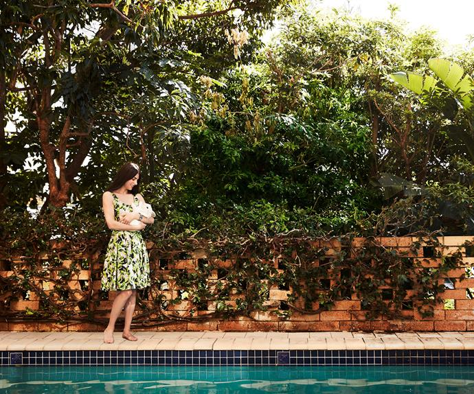 Silvia Colloca carrying her pet rabbit by a pool