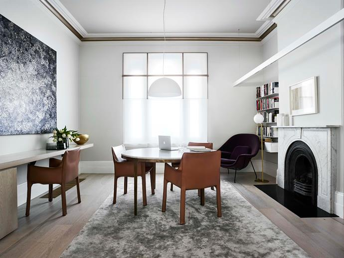 In the formal dining room, 'Moonlight' artwork by Simon Taylor hangs above the study desk. Cassina 'Cab' chairs from Space surround a Barbera dining table from Catapult.