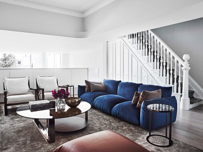 Robust fabrics in deep hues were chosen for the living room in order to withstand the demands of family life.