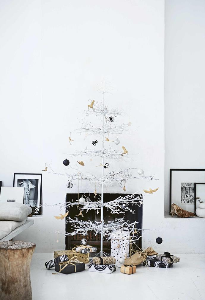"""**Painted tree** Native thorn branches attached to a stand have been painted white to allow the decorations to take centrestage. Keep your tones to a cohesive colour scheme – the black, white and natural tones here reflect Shelley's overall look, one that is pared back, textural and eclectic. Timber birds from [Africa Nova](http://africanova.co.za/