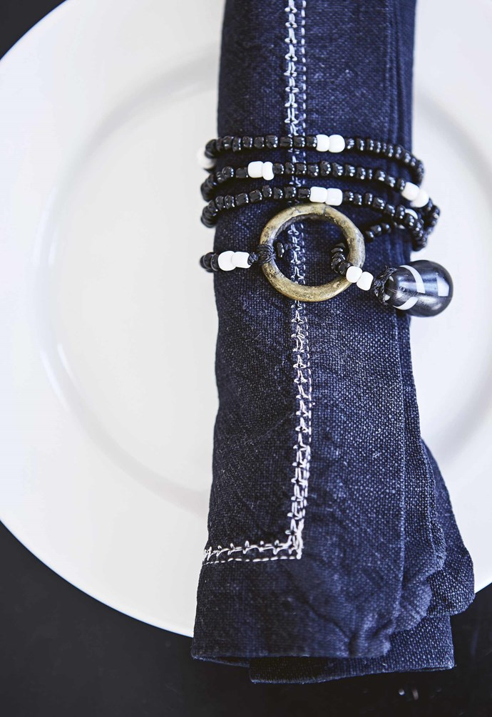 "**Napkin dressing** A beaded necklace is a playful substitute for a [napkin ring](https://www.homestolove.com.au/how-to-make-a-christmas-napkin-ring-10401|target=""_blank"") and can be a bonus take-home gift for family and friends.  *Styling by Shelley Street 