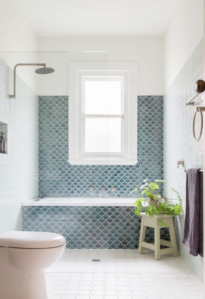 "**Fishscale** Handmade fish scale tiles become a key feature in this [bathroom](https://www.homestolove.com.au/17-best-bathrooms-ideas-to-take-for-your-own-17876|target=""_blank"") with a generous window becoming the highlight. *Project: [Brave New Eco](http://www.braveneweco.com.au/