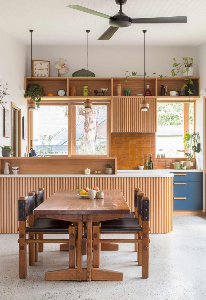 "**Dining zone** A [generous timber dining table](https://www.homestolove.com.au/how-to-choose-a-dining-table-15137|target=""_blank"") is paired with leather and timber dining chairs in the [kitchen](https://www.homestolove.com.au/kitchens-with-clever-design-ideas-to-steal-6962