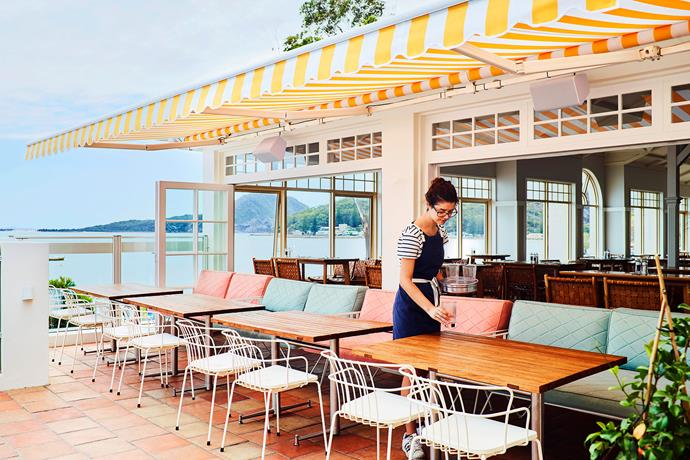 """The SBCC's outdoor terrace, with its comfy lounges and [yellow-striped folding awning](https://www.homestolove.com.au/outdoor-awnings-and-blinds-3962 target=""""_blank""""), is the ideal spot to sit back and enjoy a bite to eat."""