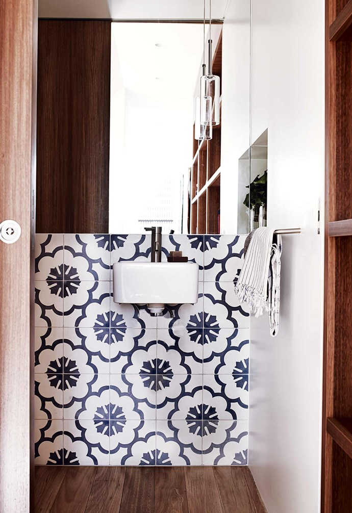 """**What's your favourite part of the house?** The sitting room, which is really the sitting/dining/kitchen/garden room.<br><br>**Bathroom / Suzanne's home** """"A favourite of Alice's, these are beautiful hand-painted concrete tiles from Bali,"""" says Andrew."""