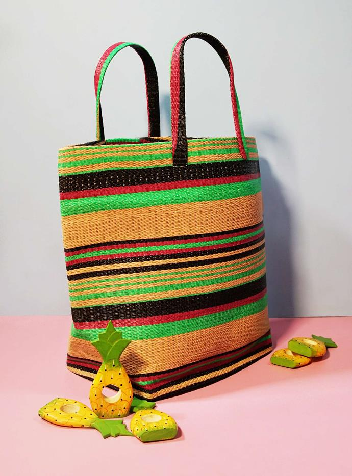 "This bag is made in Ghana from repurposed plastic. Togo bag in Red Brown Stripe, $75, from [Yevu](https://yevuclothing.com/|target=""_blank""