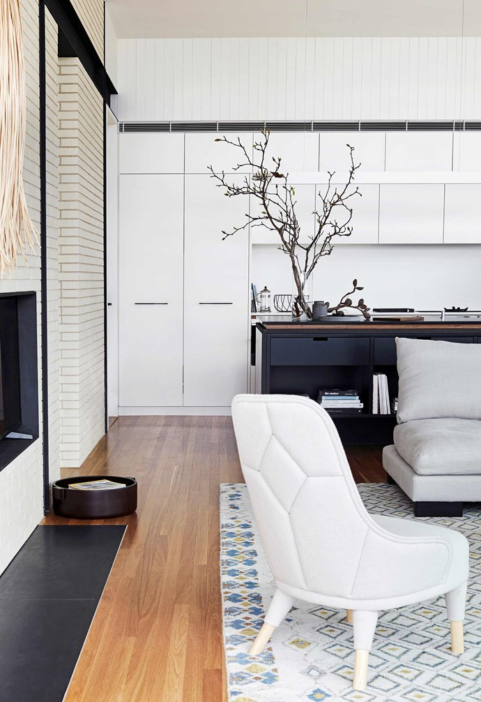 """**Colour palette** White cabinetry provides a simple backdrop or the dramatic dark kitchen island. Tribute Lamp Table with Palomino Marble Top, [Zuster](https://zuster.com.au/